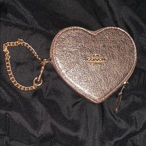 Rose gold heart shaped coach wristlet